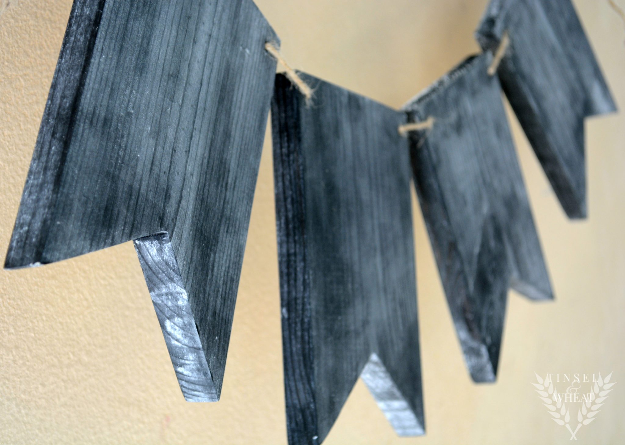 DIY Wood Chalkboard Banner by Tinsel & Wheat - a must have for any holiday, birthday party, wedding, or any other kind of decor... Personalize each pennant with whatever letter you need. Cheap, EASY, and so cute!!