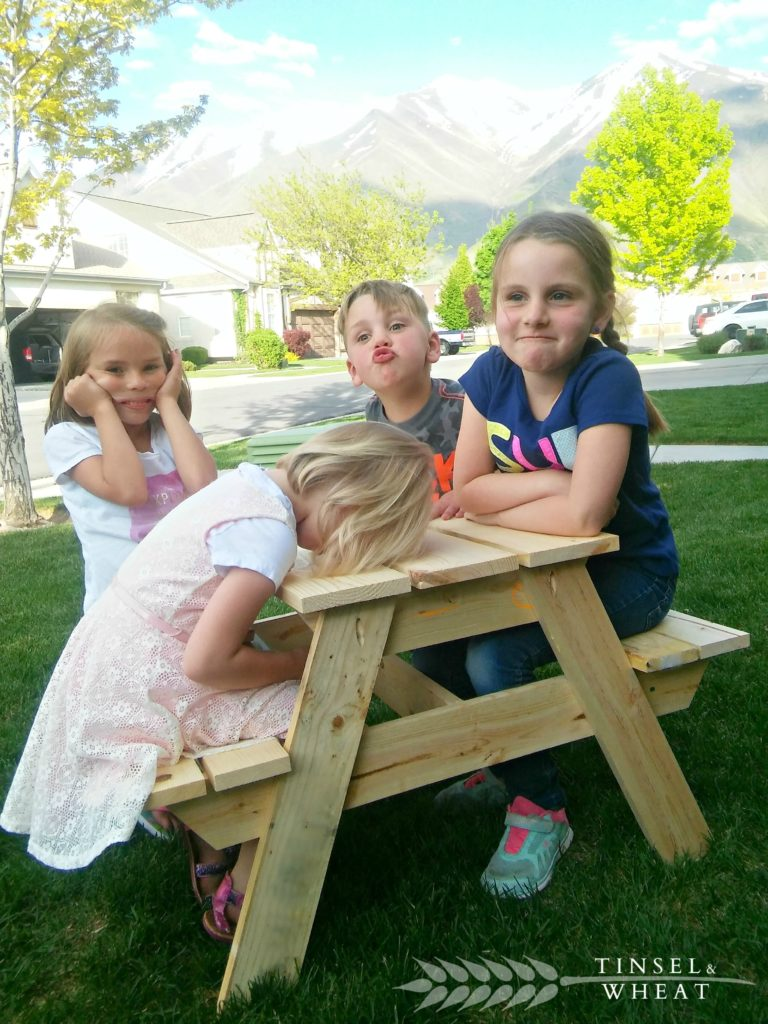 Four Kids Sitting on Recently Assembled Kids Picnic Table