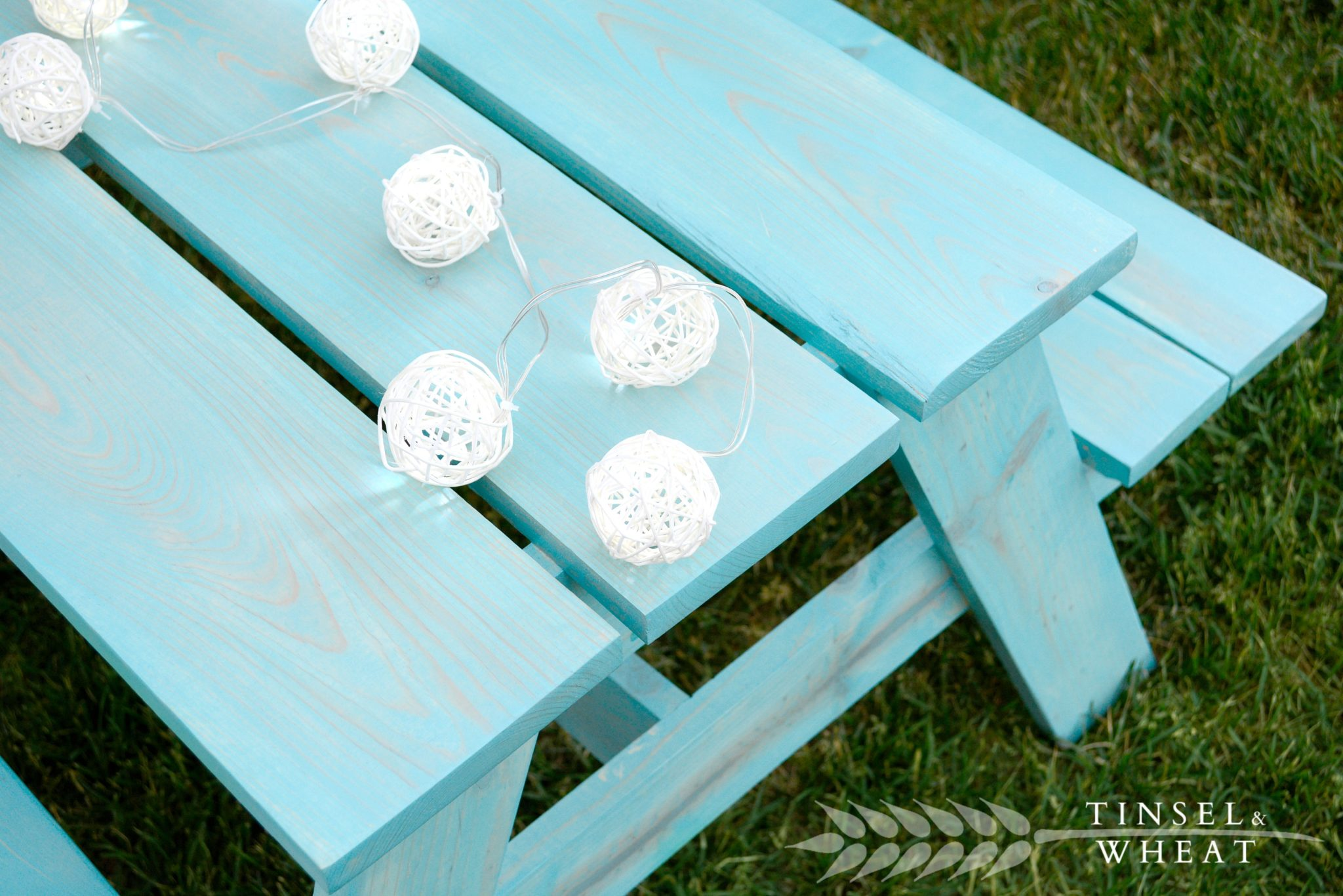 Light Blue Kids Picnic Table with Lights Laying on Top