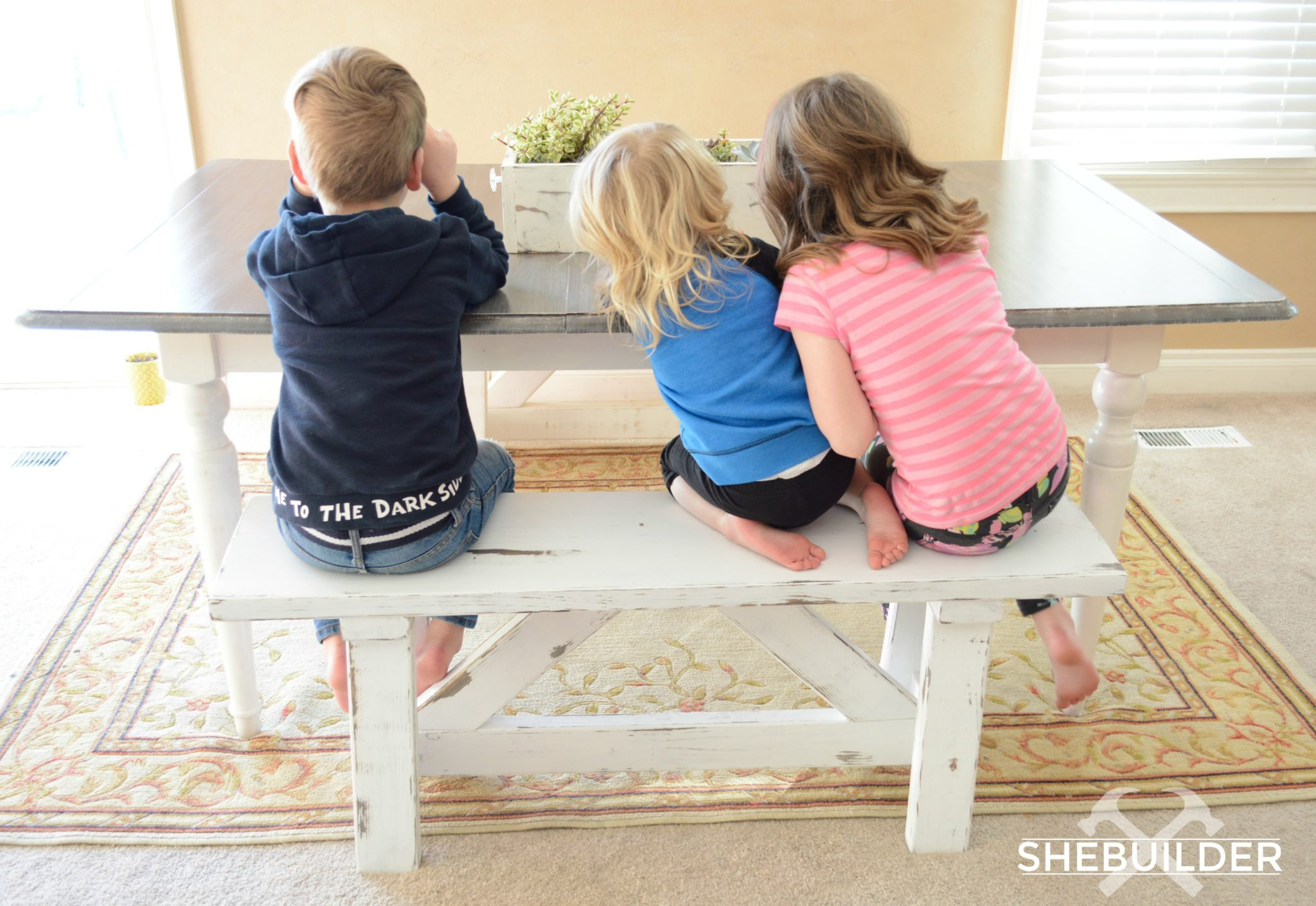 3 Kids Sitting on Farmhouse Bench at Kitchen Table